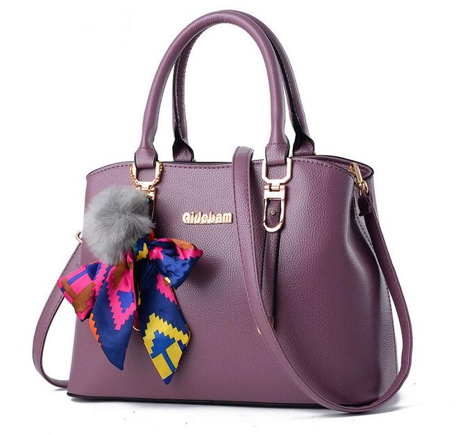 [ Pre-Order ] - กระเป๋าแฟชั่น ถือ/สะพาย สีม่วง ทรงตั้งได้ แต่งโบว์ป้อมเก๋ๆ ดีไซน์สวยเรียบหรู ดูดี งานหนังคุณภาพ ช่องใส่ของเยอะ