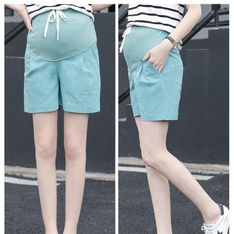 กางเกงขาสั้นพยุงท้องสีเขียว เอวมีสายรูดปรับระดับได้ตามอายุครรภ์ ผ้ายืด ใส่สบาย น่ารักมากๆค่ะ